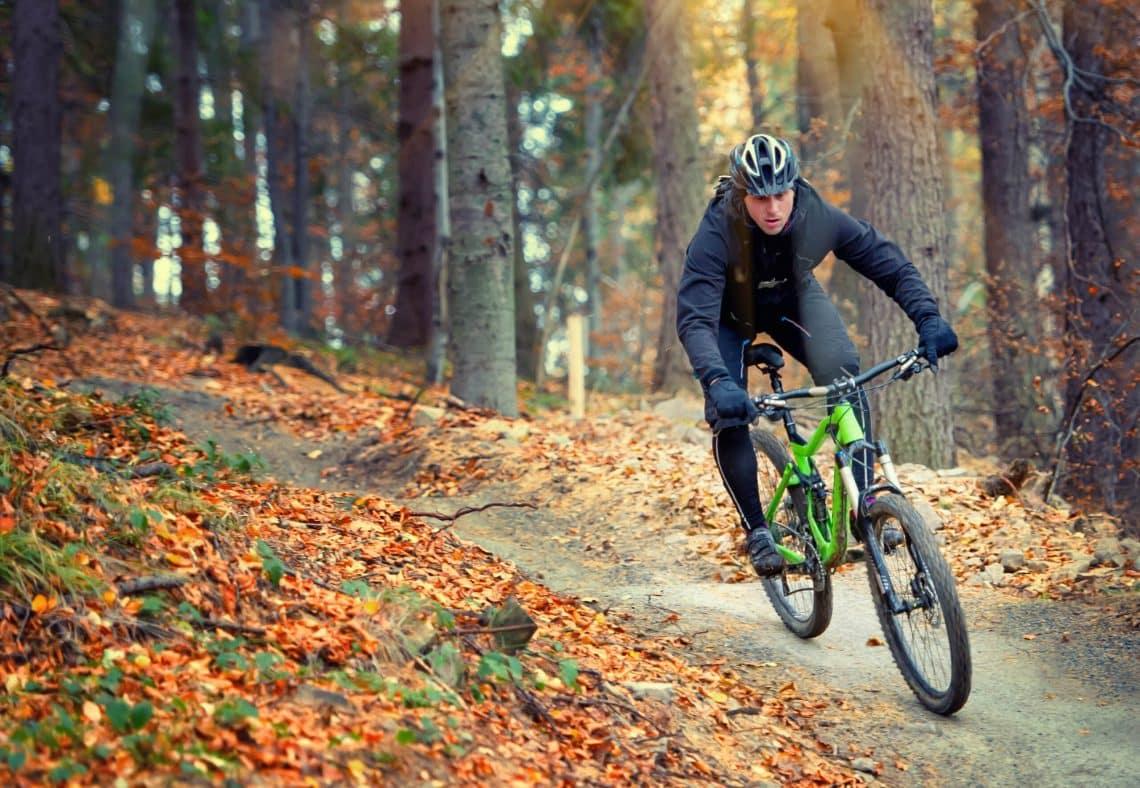 Mountain,Biker,Riding,In,Autumn,Forest